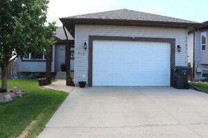 Main Floor Suit,  2 bed/2 full bath with attached Double Garage.