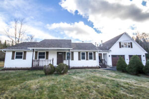 HUGE HOME WITH DETACHED GARAGE ON AN ACRE LOT