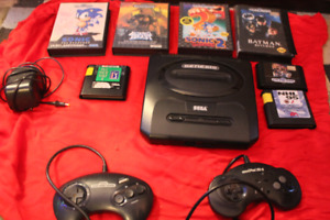 VINTAGE SEGA GENISIS WITH  7 GAMES  INCLUDING SONIC 1 AND 2