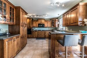 Beautiful two story on 3/4 acre lot in Torbay !