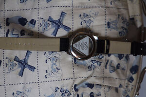GUESS 25TH ANNIVERSARY WATCH WITH RHINESTONES AND SEE THRU BASE