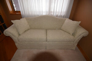 Like New Off White fabric Sofa and Two Cushions - REDUCED PRICE