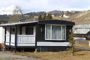 NICE MOBILE HOME ON ITS OWN LOT IN CROWSNEST PASS