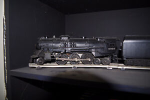 Lionel O-27 Gauge steam engine with 6 cars and lots of track