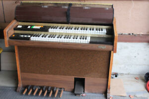 An Old Hohner Electric Keyboard Piano In Working Condition