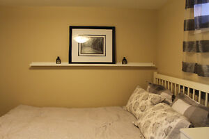 COZY, BRIGHT, FULLY-FURNISHED, ONE-BEDROOM SUITE IN CENTRE