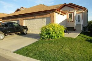 SPECTACULAR! WALKOUT BUNGALOW - BACKING ONTO GREEN SPACE