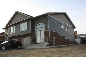 Almost new raised bungalow semi detached home for Sale in Garson