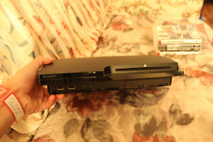 PS3 in perfect condition with games/3 controller NEGOTIABLE