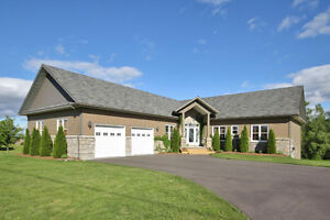 SIMPLY STUNNING BUNGALOW IN GREELY WITH FULL WALK OUT BASEMENT