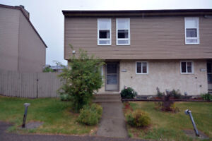 ***PRICE REDUCED*** FOUR bedroom townhome with LARGE yard!