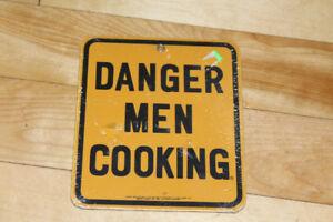 Ande Rooney 'Danger Men Cooking' Porcelain Enameled Metal Sign