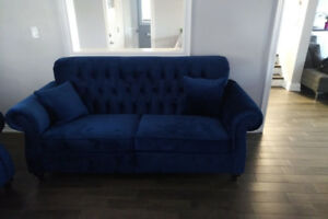 Brand new tufted royal blue couch and loveseat.