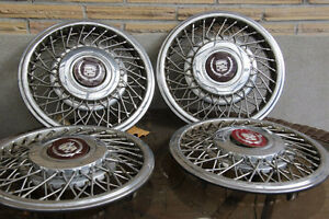 Set of 4 wire rim hubcaps for a 1989 Cadillac Deville Kitchener / Waterloo Kitchener Area image 1