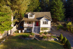 A sunny oasis on Bowen Island plus a magical, forested backyard