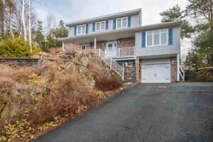 Well Maintained Home with Built-in Garage in Bedford Hills!