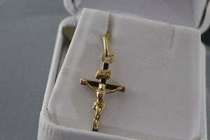 BRAND NEW STAMPED WITH RECEIPT 10K. GOLD CROSS FOR SALE