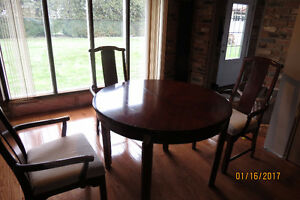 Round Cherry, Dining room Table and chairs