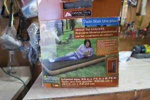 New twin camping bed still in box