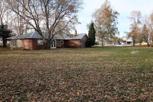 4.95 Acres with Home Near Coaldale - Already Subdivided!