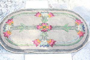 Antique floral themed hooked mat