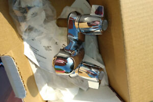 2 new in box Delta faucets