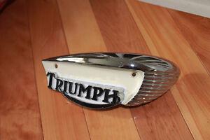 Triumph tank badges.