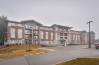 End Unit Condo Backing Onto Greenspace