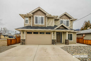 Gorgeous Basement Entry Home With Legal 2 Bedroom Suite.