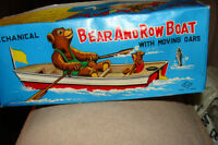 vintage s&e japanese tin toy rowing bear in his boat