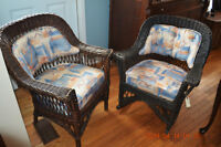 Comfortable vintage wicker chair and rocker with cushions