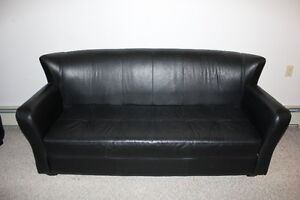 a black leather 3 -seat and a armchair sofa set