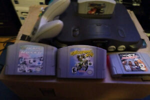 n64 console with one gamepad and 4 cartrage games