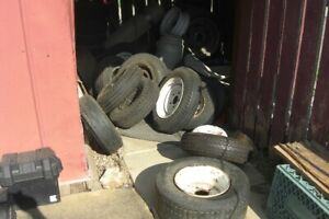 USED TRAILER TIRES ON 4 AND 5 HOLE RIMS