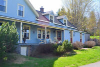 Century farmhouse in immaculate shape, with ~20 acres