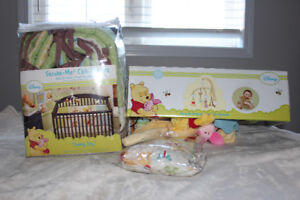 Winnie the Pooh crib bedding set and mobile