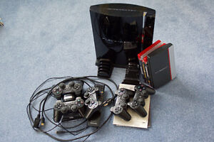 Playstation 3 with charging station,controllers and PS remote.