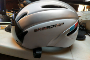 Base camp cycling helmet with removable shield visor