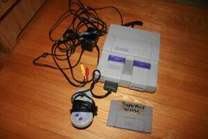 Super nintendo console with super mario world