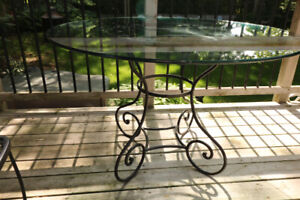 """48"""" Round Glass Table with wrought iron base and 4 chairs"""