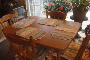 solid wood chairs table set with leaf $250.00....obo