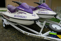 Pair of 2003 Sea-Doo GTI PWCs with double trailer.