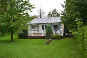 Beautiful 4 season cottage with lake and golf course view