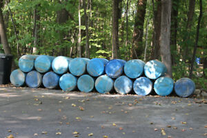 55 gallon used blue plastic barrels/drums