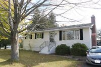 Well kept home on corner lot w/ mature trees and paved drive