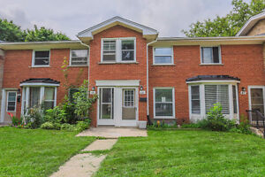 2 bedroom brick townhouse condo with wood burning fireplace