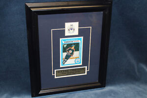 Framed Wayne Gretzky Rookie card and pin.