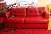 Beautiful Ashleys Red Leather Couch