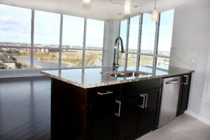 RARE LUXURY CONDO: PRIVATE ELEVATOR & 2 U/G STALLS IN WINDERMERE