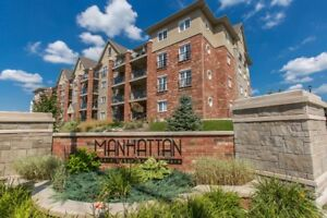 NEW PRICE! Bright Open Concept 2 Bed, 1 Bath Suite at Manhattans